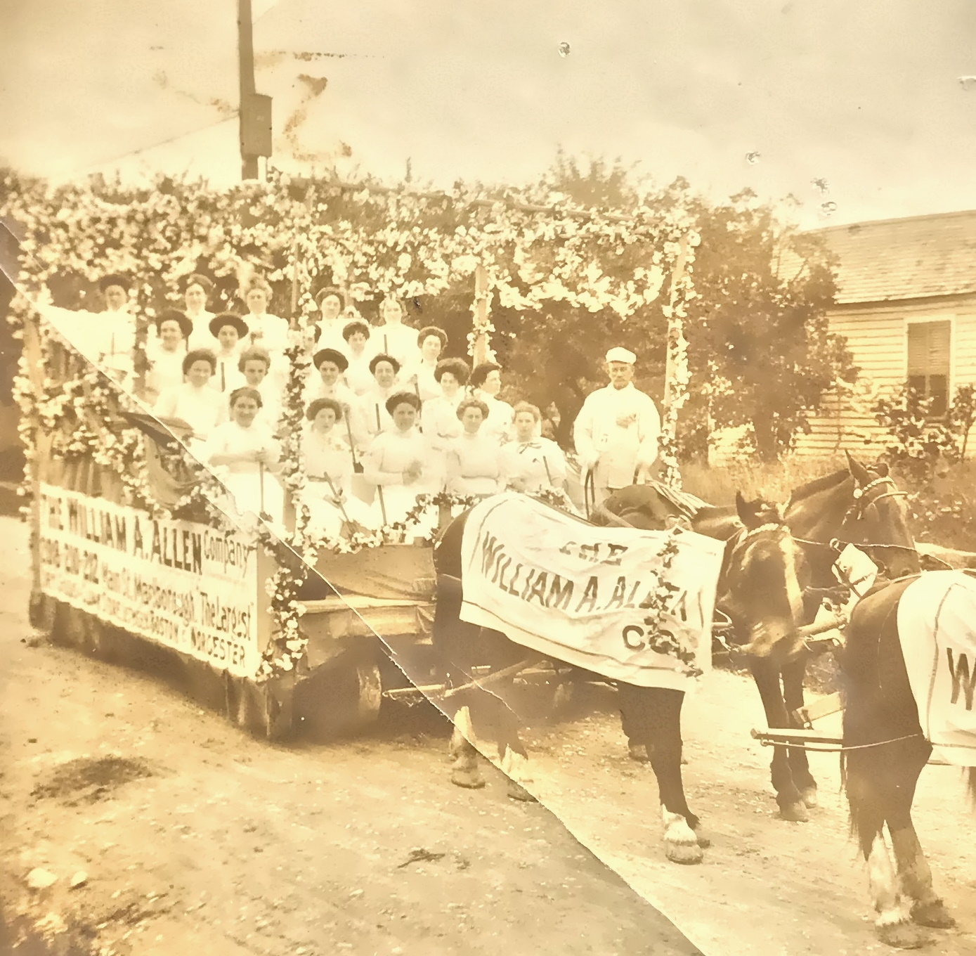A horse-drawn carriage parading some of the William A. Allen Co. workers from the Marlboro store.